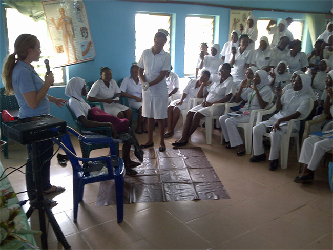 Dr-Sophia-Webster-prepares-the-excited-student-midwives-for-the-post-partum-haemorrhage-practical-discussion-in-rural-Nigeria 650x488