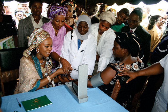 Founder-President-of--WBF-Her-Excellency-Mrs.-Toyin-Saraki-in-a-symbolic-blood-pressure-check-of-some-patients-at-the-launch-of-the-PHR-in-ilorin 650x434